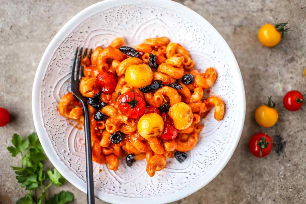 This vegan pasta alla vodka recipe, a deliciously creamy, tomato vodka sauce swirled into pasta, is the midweek dinner idea you didn't know you needed.