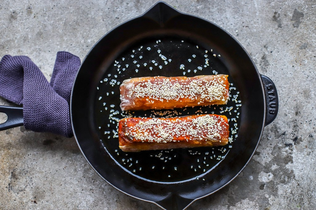 Pan-seared and oven-baked sesame Korean salmon in cast iron pan