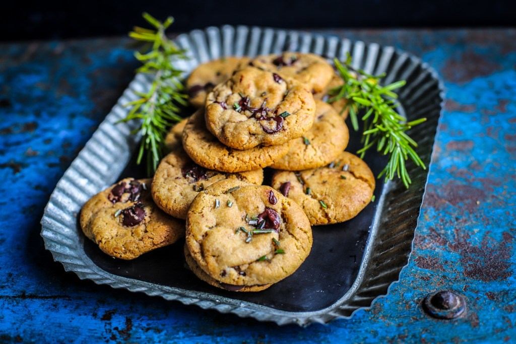 cookies at 3/4 angle on rustic tray and blue background