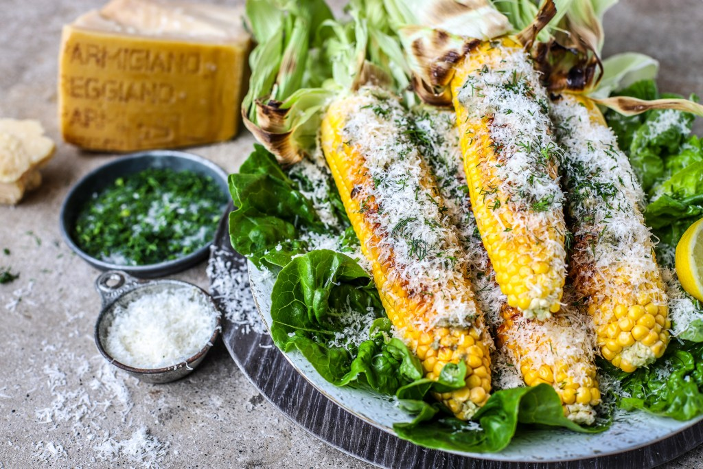 buttery grilled parmesan corn with authentic parmesan wedge alongside