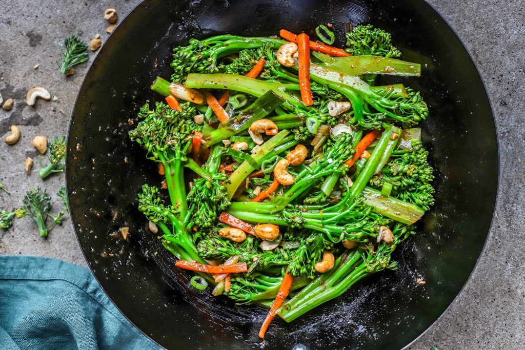 wok with stir fry vegetables on concrete background