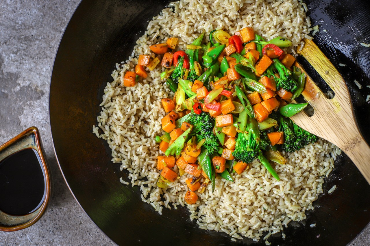 rice and vegetables in wok to make fried rice