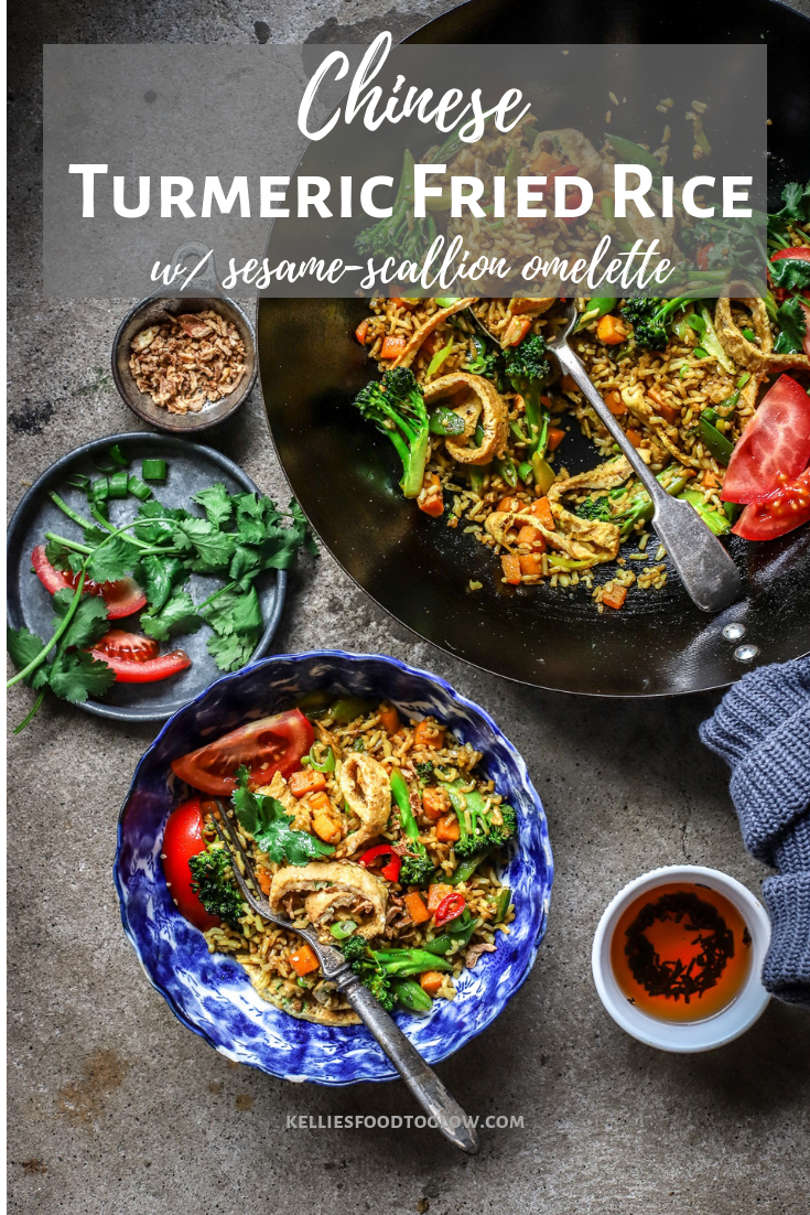 chinese turmeric fried rice in wok and served in blue bowl with garnishes
