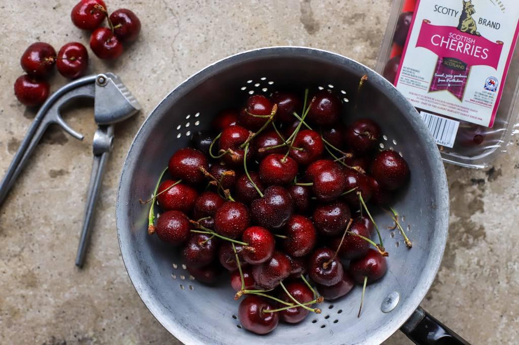 cherries in vintage colander