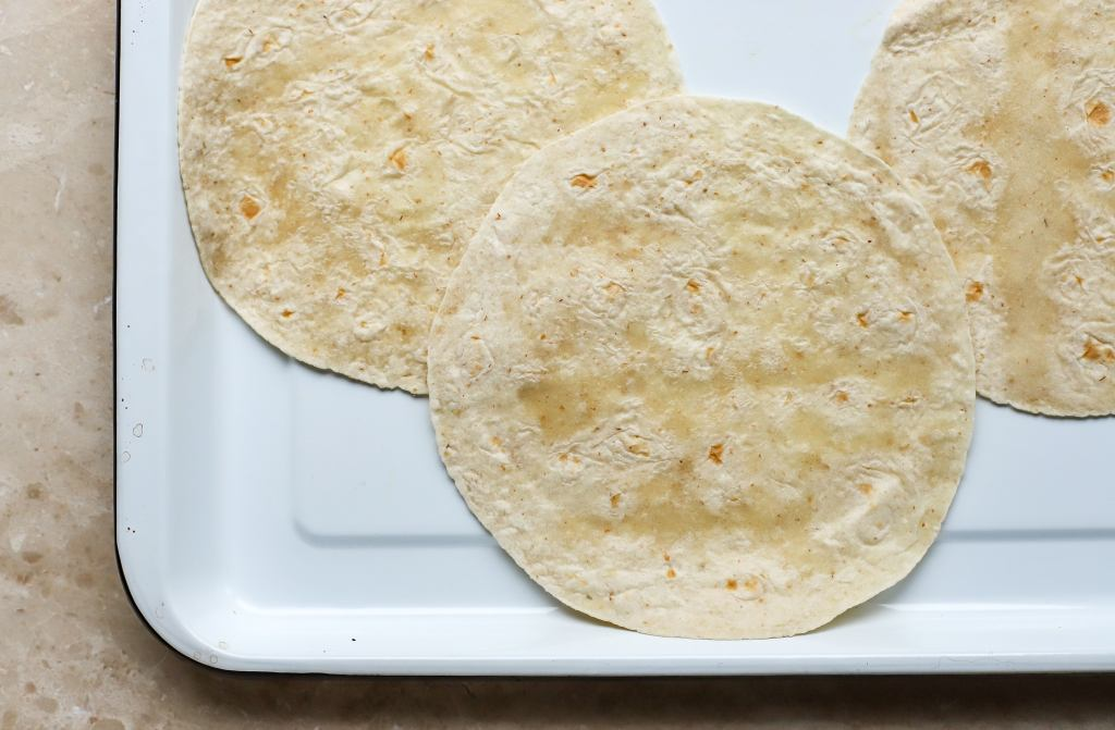 flour tortillas on white enamel tray