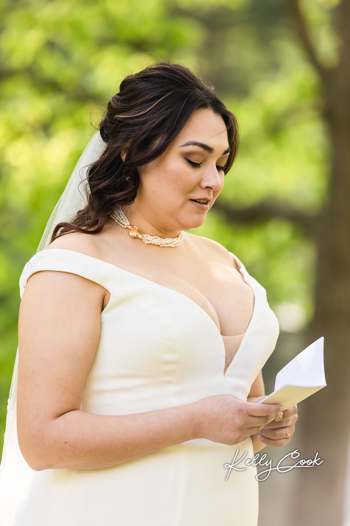 A bride reading her vows at her backyard micro wedding in St. Louis