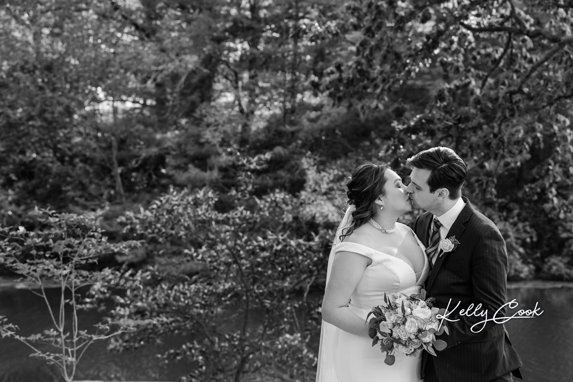 Wedding couple kissing at their backyard elopement in St. Louis