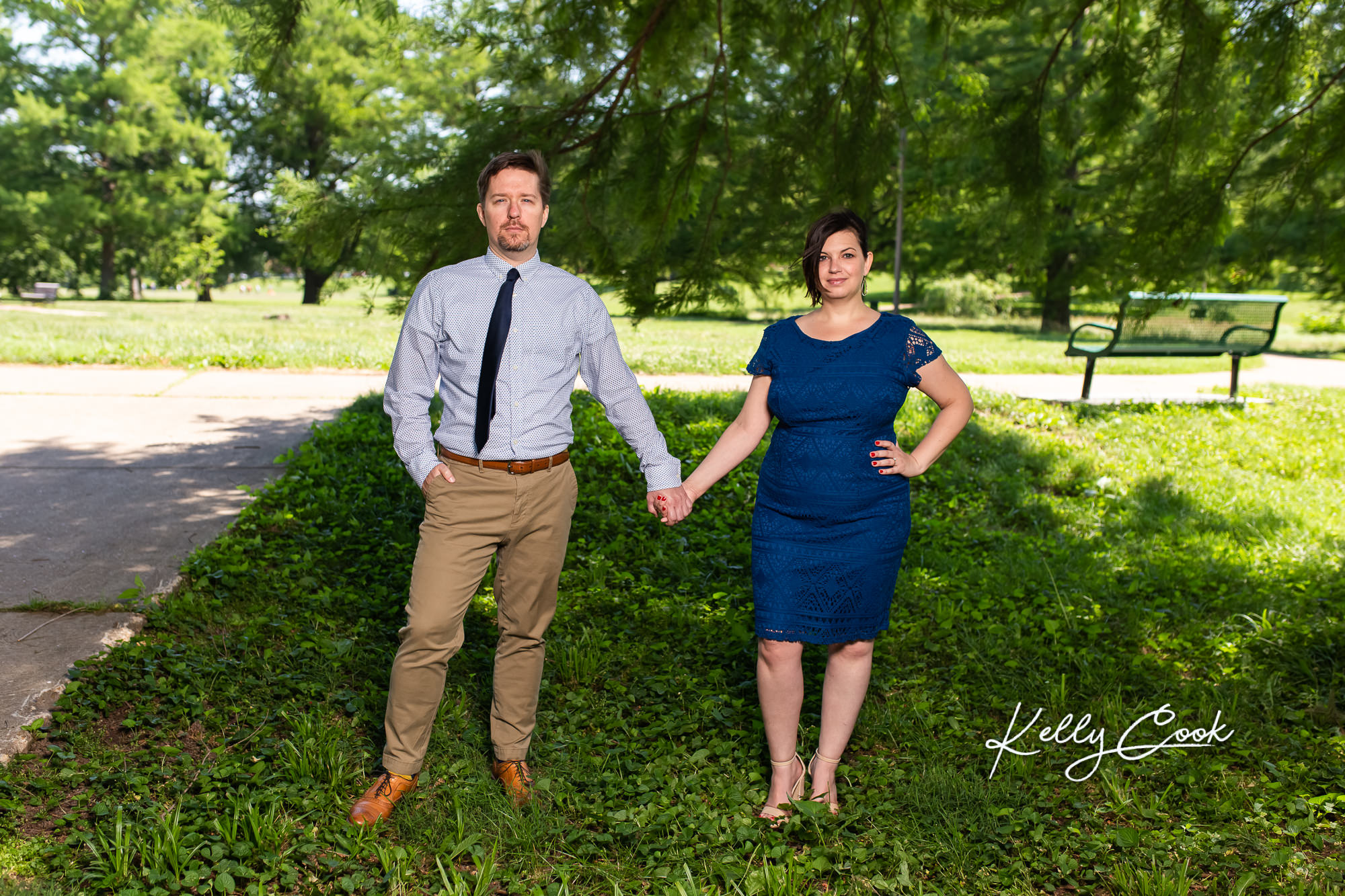 Engaged couple holding hands for St. Louis engagement photos in Francis Park