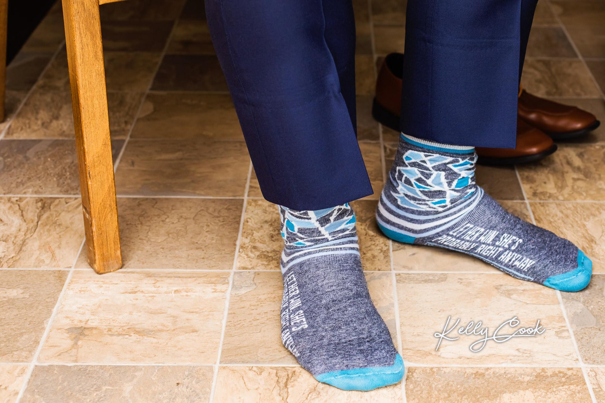 Wedding detail photo of the groom's fun socks