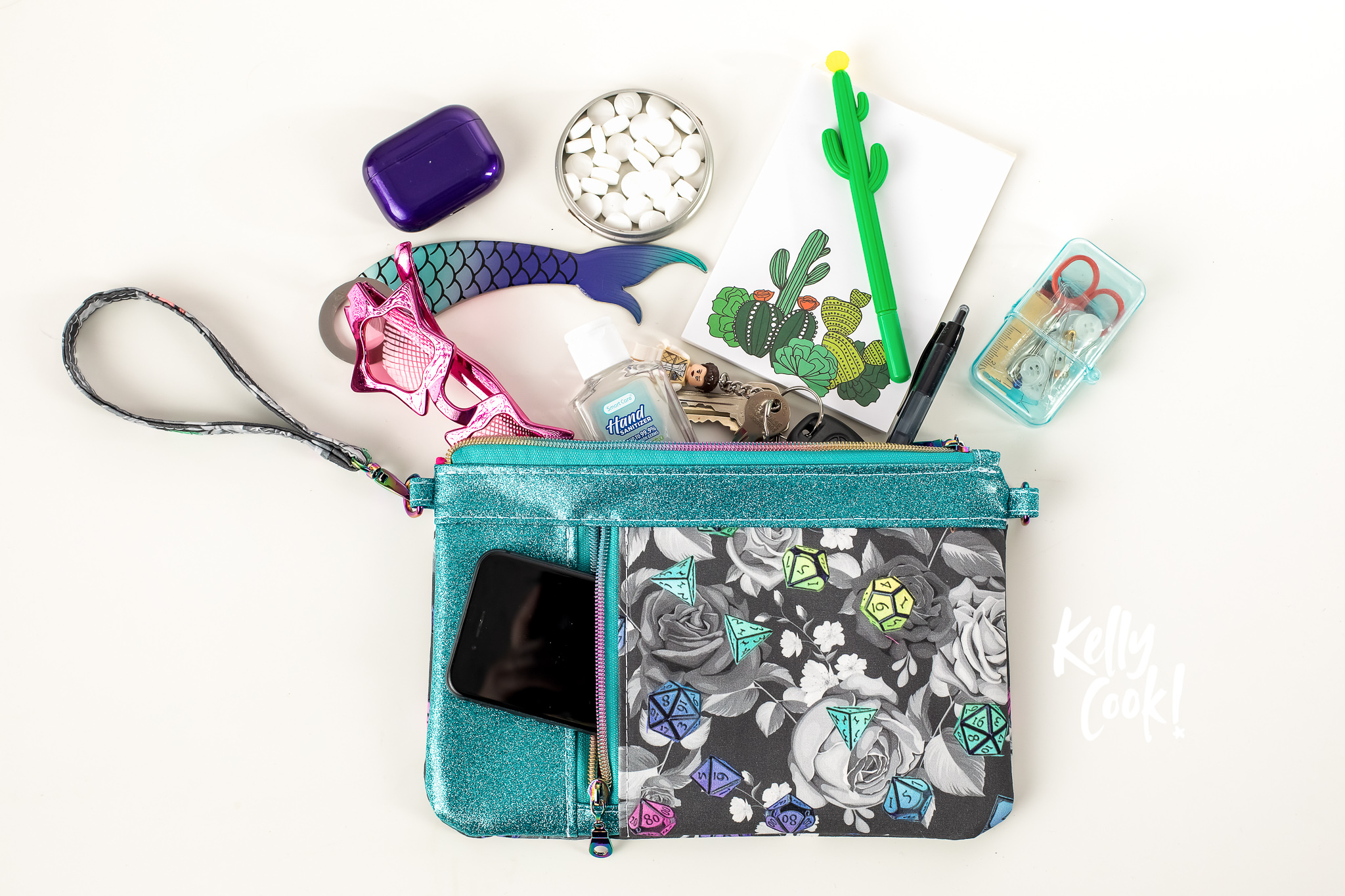 A geeky clutch with it's contents spilling onto the table