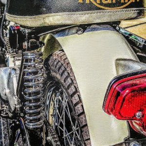Photograph of a Vintage Triumph Motorcycle Seat on Canvas