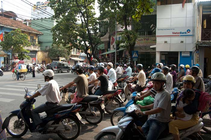 Scooters stopped at Hanoi traffic light