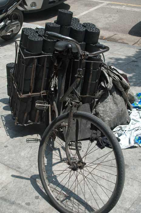 Hanoi bicycle with charcoal in carriers.