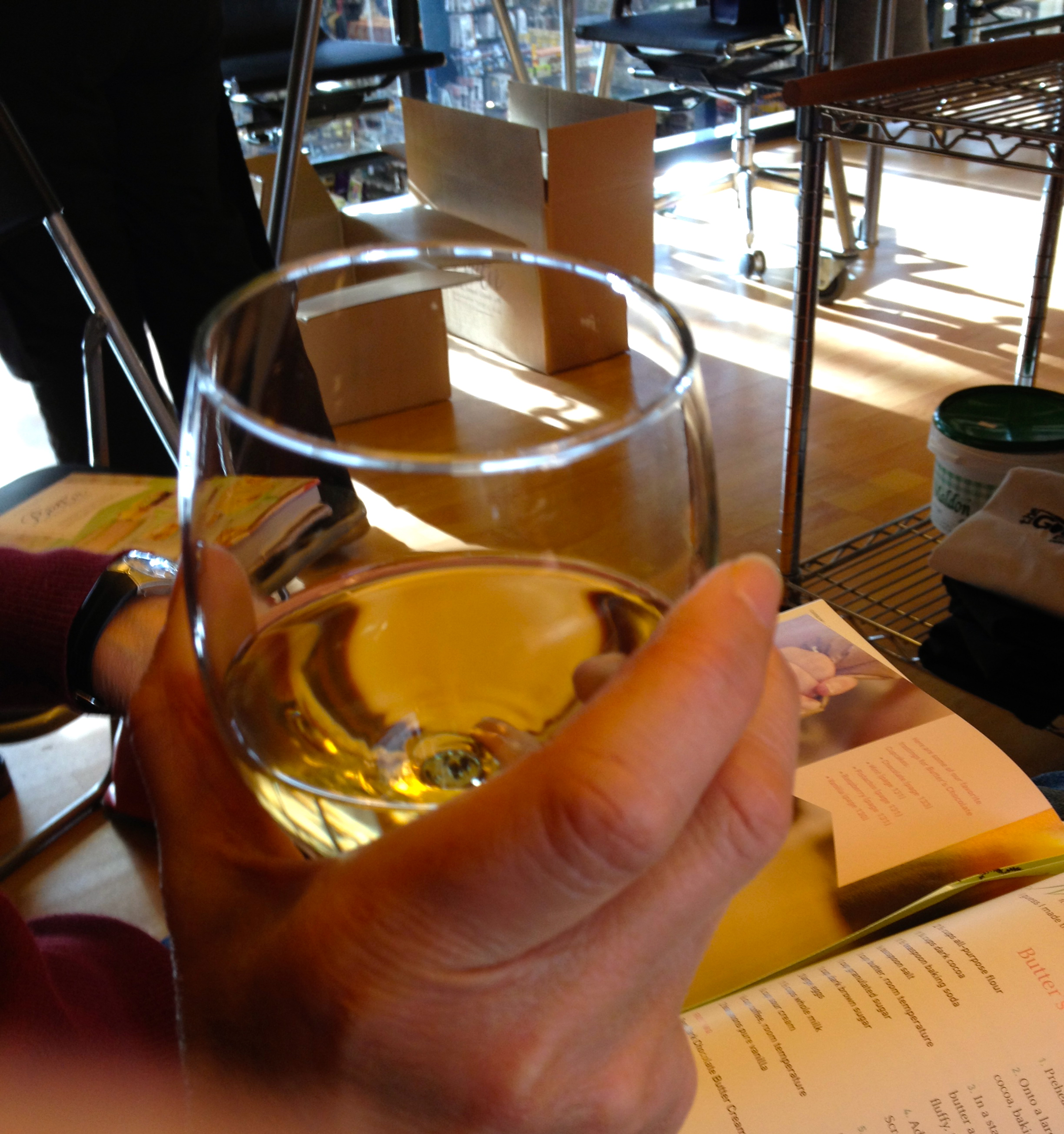 grasping glass of white wine http://kellylmckenzie.com/Christmas-on-the-road/