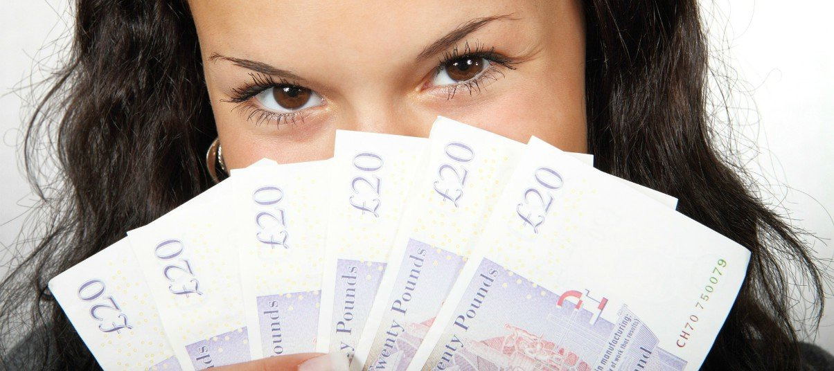 woman money British pound