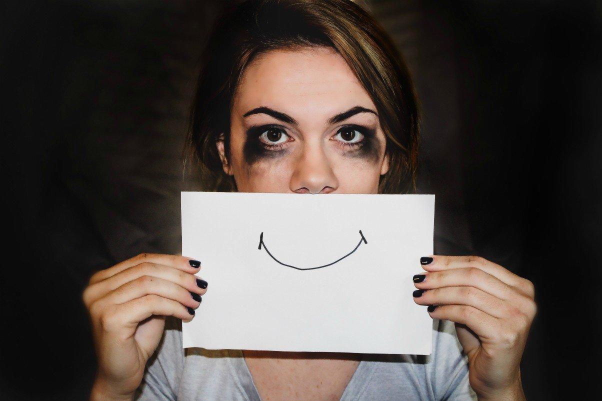 sad happy woman depression