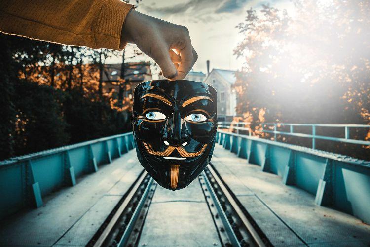 feeling like a fake impostor syndrome mask