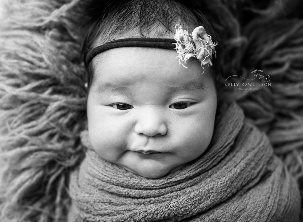 Black and white newborn photograph from professional photographer in Georgina