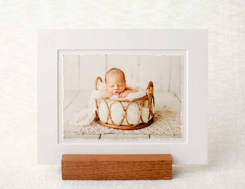 Fine Art Newborn photo displayed on an easel