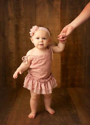 One year old photoshoot, girl holding moms hand, print these photographs