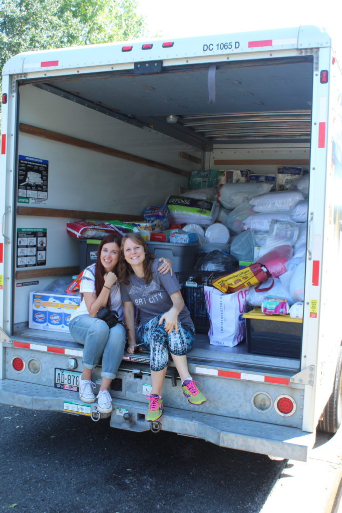 Family gathers supplies for flood evacuees