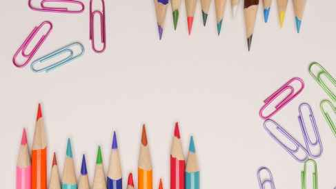 photo of color pencils and colorful paper clips. Coloured pencil artists dream