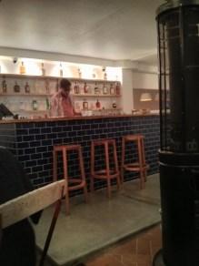 Blue tiled, fully-stocked bar