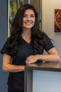 Picture of Stacey MacAulay, Denturist, standing in the reception area at Kelowna Denture Clinic