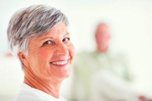 Smiling woman wearing partial denture