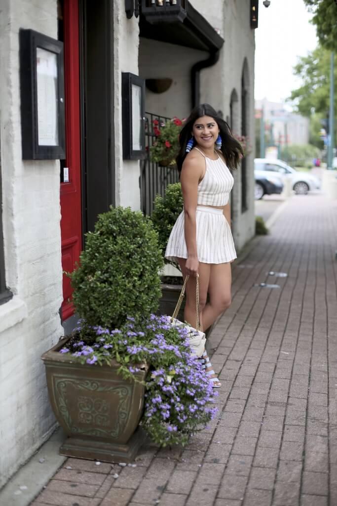 Lifestyle blogger Kelsey Kaplan of Kelsey Kaplan Fashion wearing two-piece set and tassel earrings