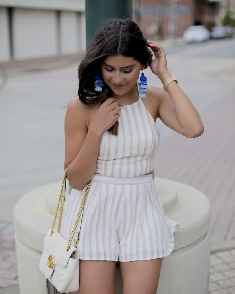Lifestyle blogger Kelsey Kaplan of Kelsey Kaplan Fashion wearing two-piece set and blue tassel earrings