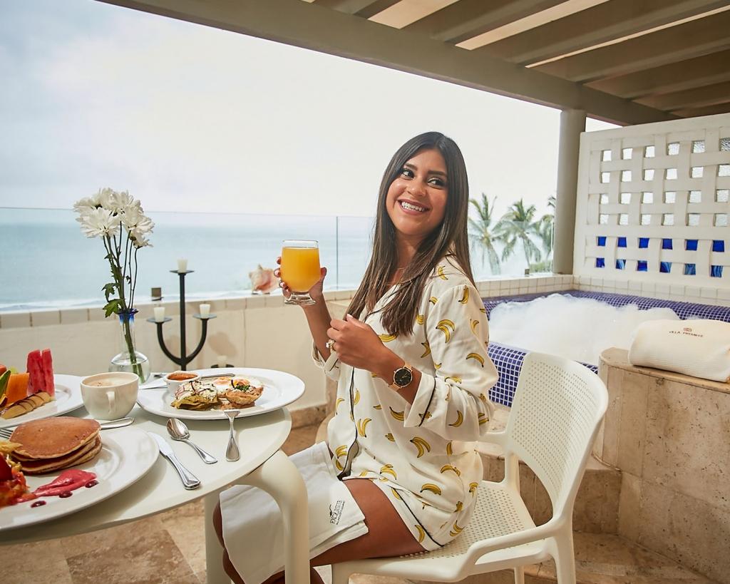 Lifestyle blogger Kelsey Kaplan of Kelsey Kaplan Fashion wearing banana print pajamas