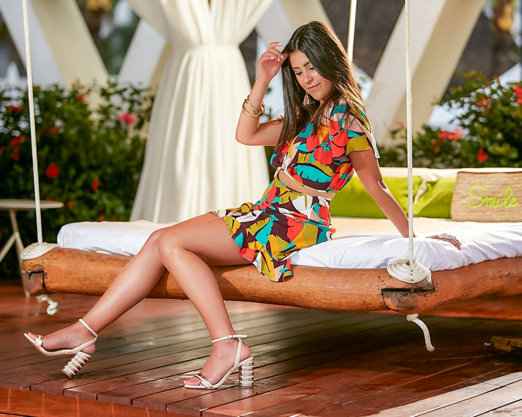 Lifestyle blogger Kelsey Kaplan of Kelsey Kaplan Fashion wearing tropical print romper and rose gold sandals
