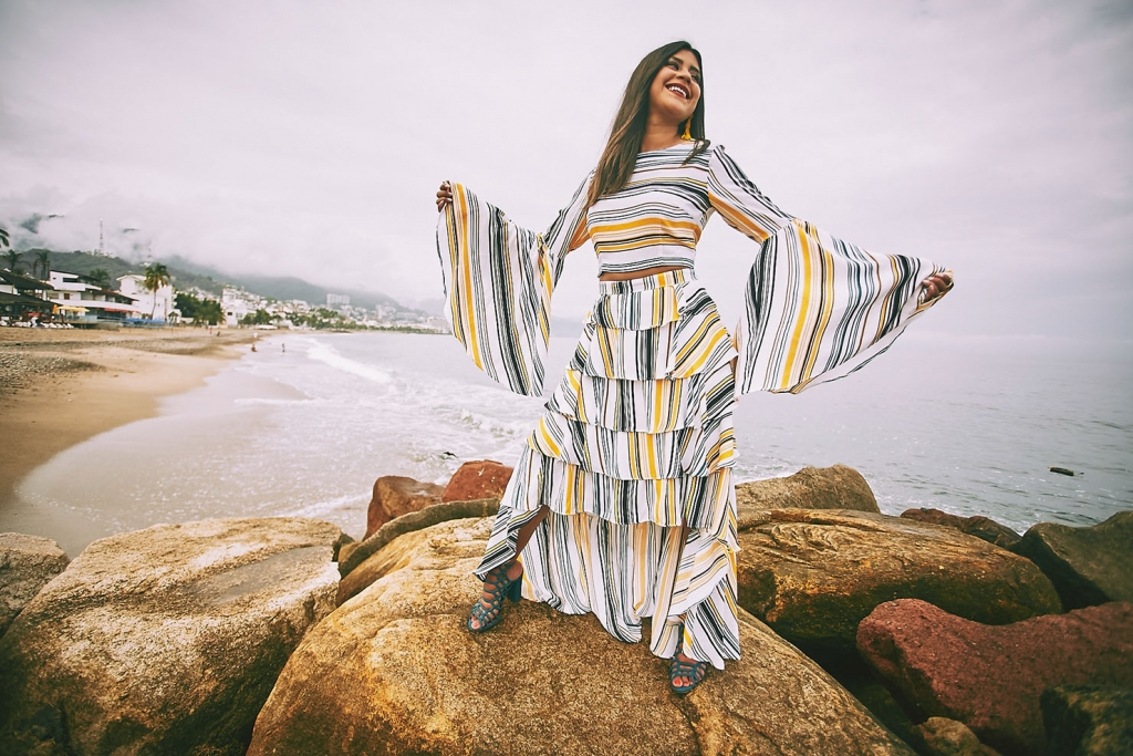 Life style blogger Kelsey Kaplan of Kelsey Kaplan Fashion wearing striped two-piece dress