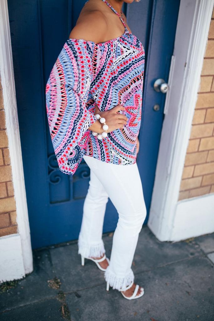Kelsey Kaplan of Kelsey Kaplan Fashion in white fringe hem jeans and Brynn Hudson Jewelry
