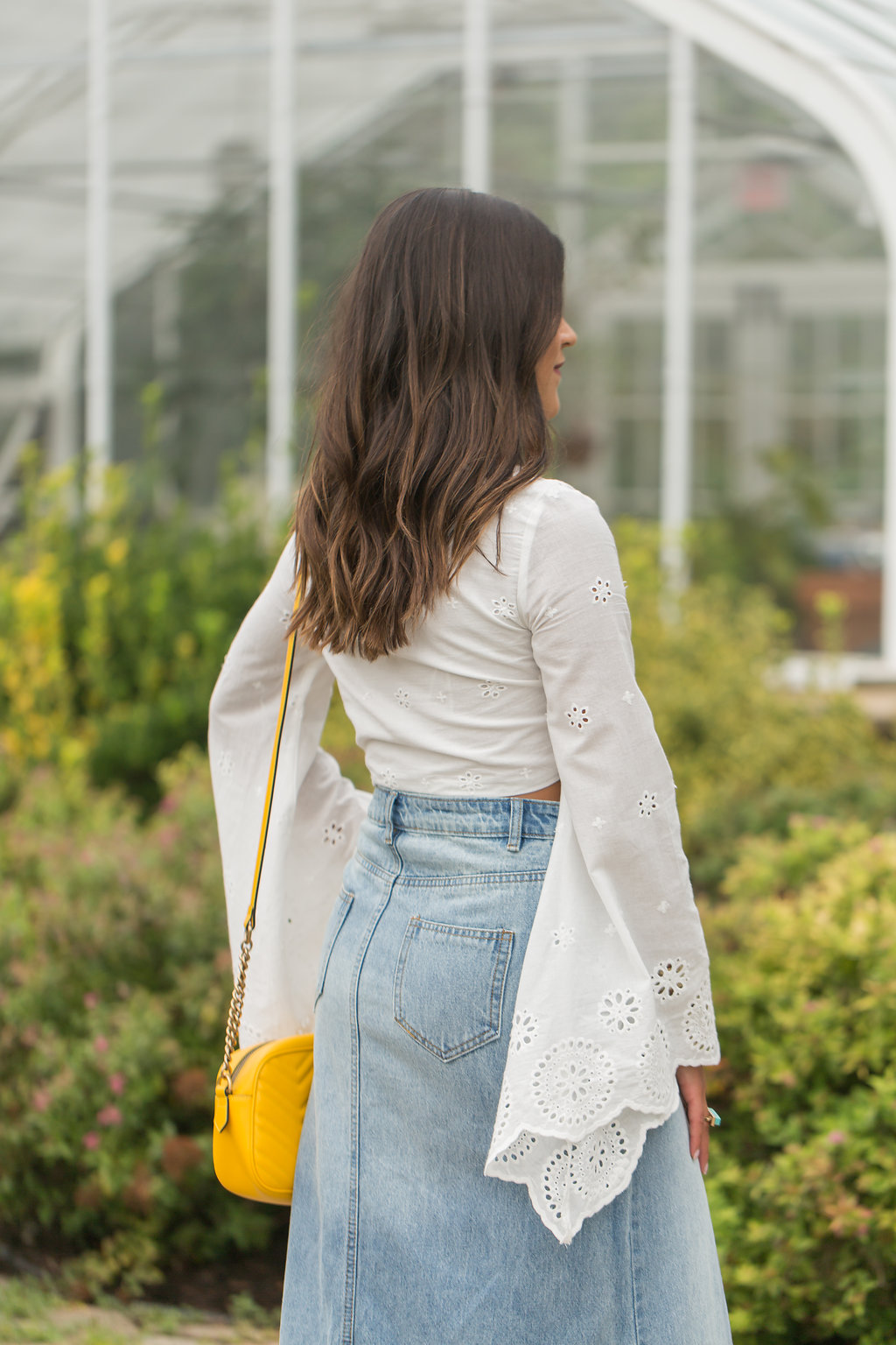 Lifestyle Blogger Kelsey Kaplan of Kelsey Kaplan Fashion wearing denim maxi skirt and yellow Gucci Purse