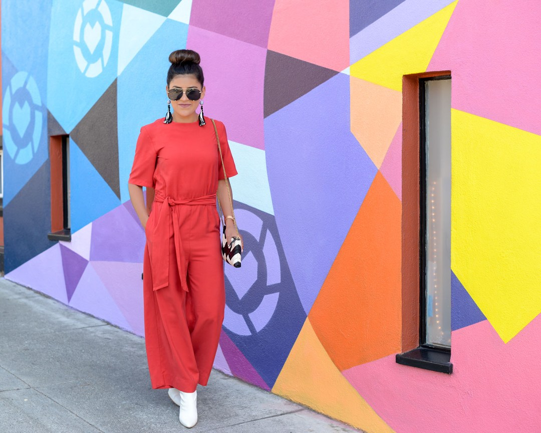 Lifestyle blogger Kelsey Kaplan of Kelsey Kaplan Fashion at LIKEtoKNOW.it wall wearing white booties and chevron gucci purse