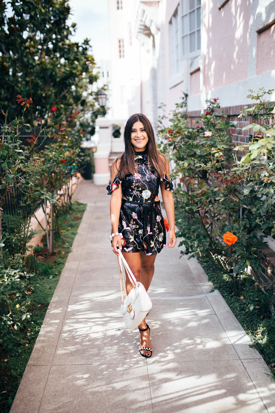 Lifestyle blogger, Kelsey Kaplan of Kelsey Kaplan Fashion wearing sequin romper and pearl Stuart Weitzman sandals
