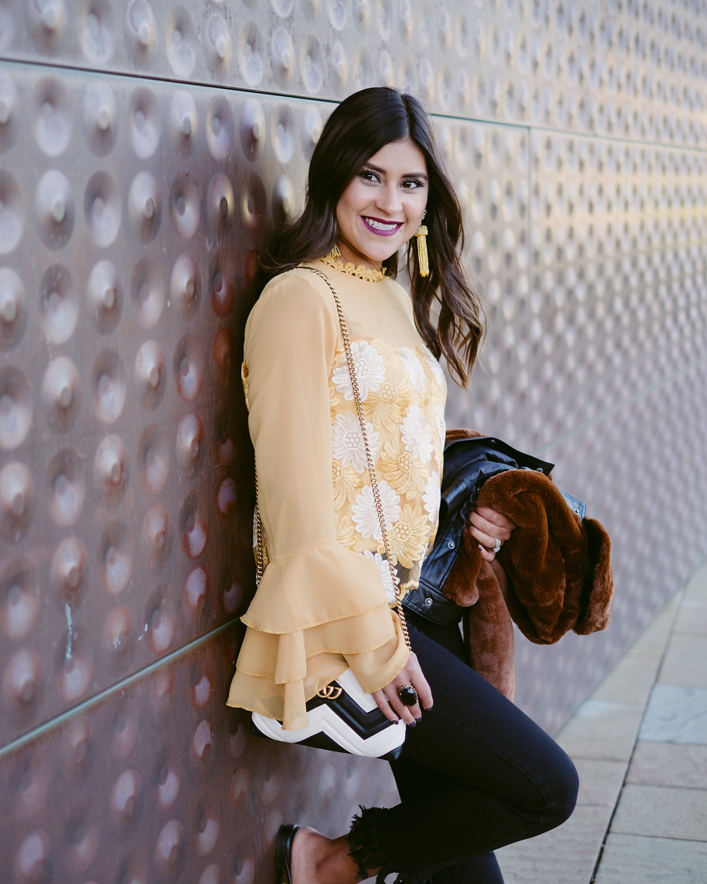 Life style blogger Kelsey Kaplan off Kelsey Kaplan Fashion wearing chevron Gucci purse and gold tassel earrings