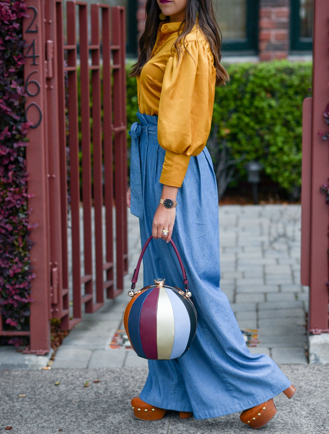 Lifestyle blogger Kelsey Kaplan of Kelsey Kaplan Fashion wearing wide leg pants and bowling ball bag