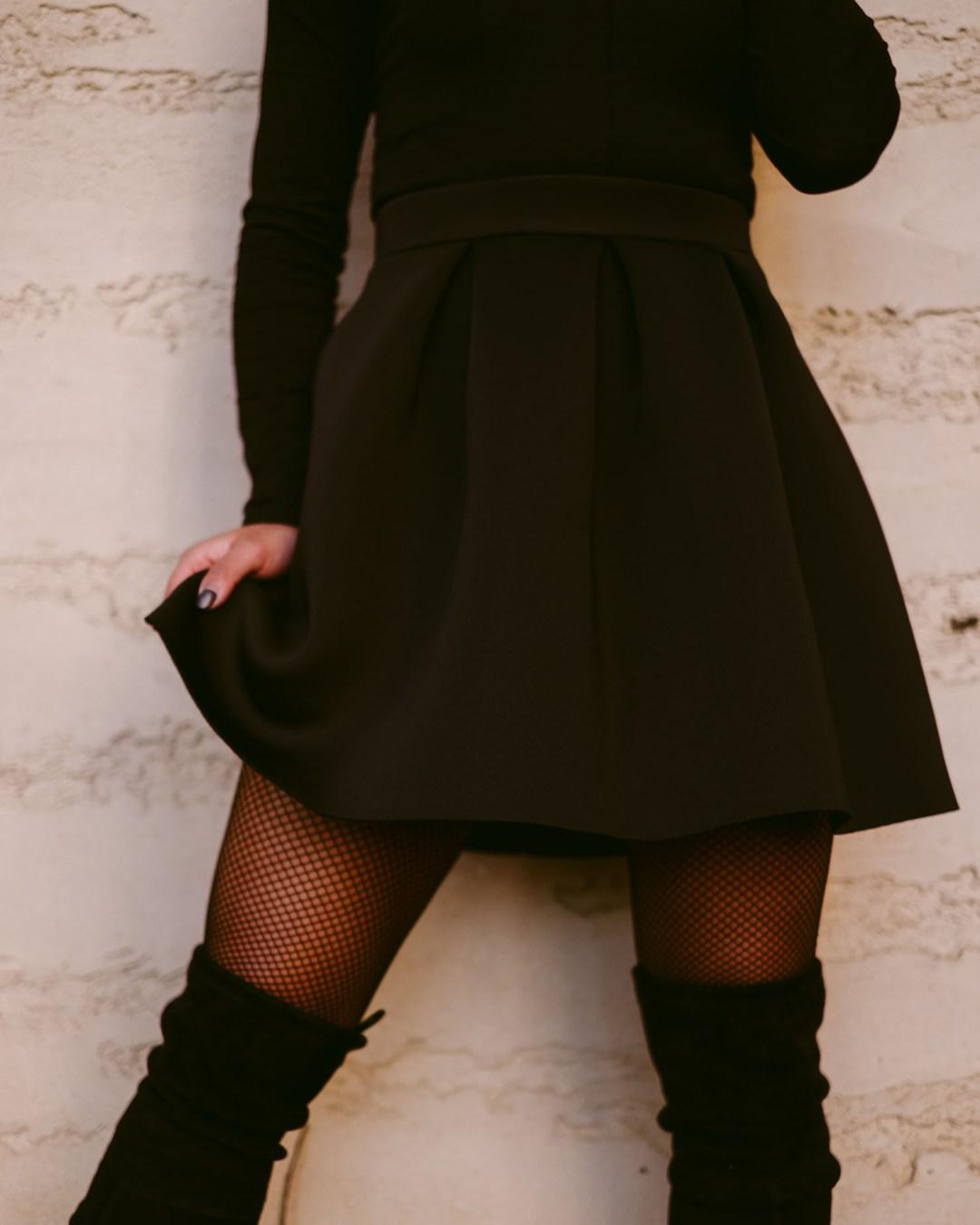 Lifestyle blogger Kelsey Kaplan of Kelsey Kaplan Fashion wearing fox mask and fishnet stockings to costume party