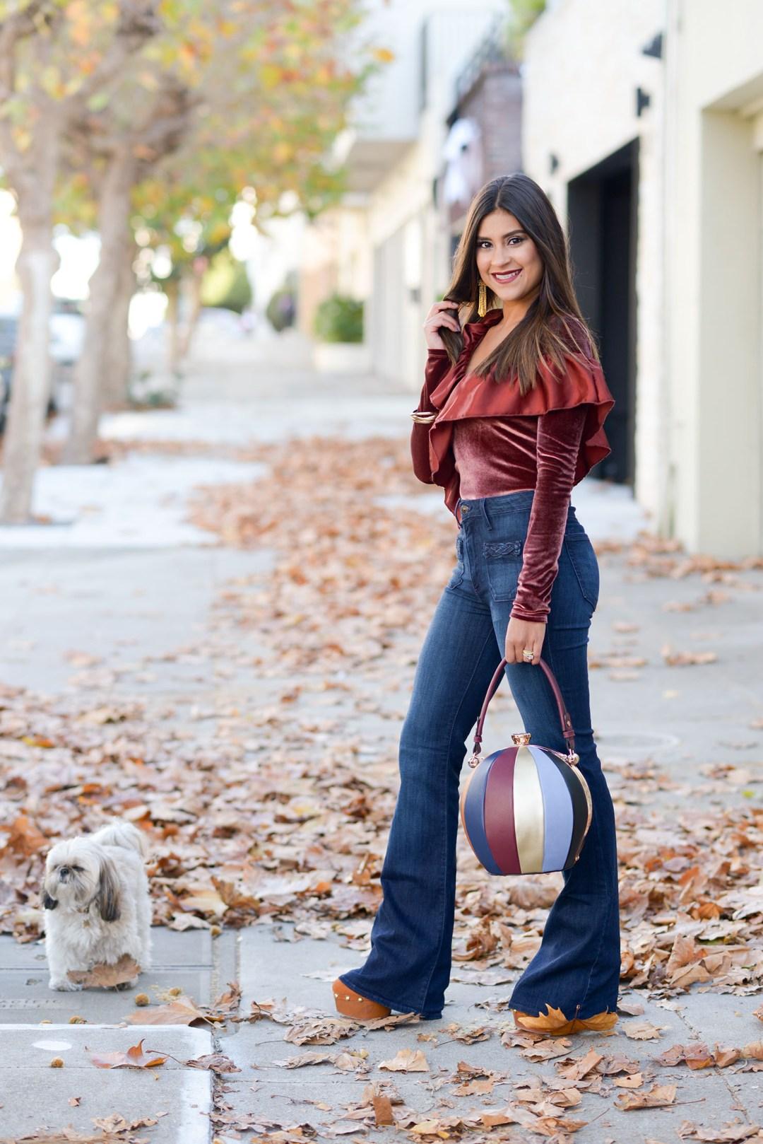 Lifestyle blogger Kelsey Kaplan of Kelsey Kaplan Fashion wearing velvet bodysuit and flare jeans