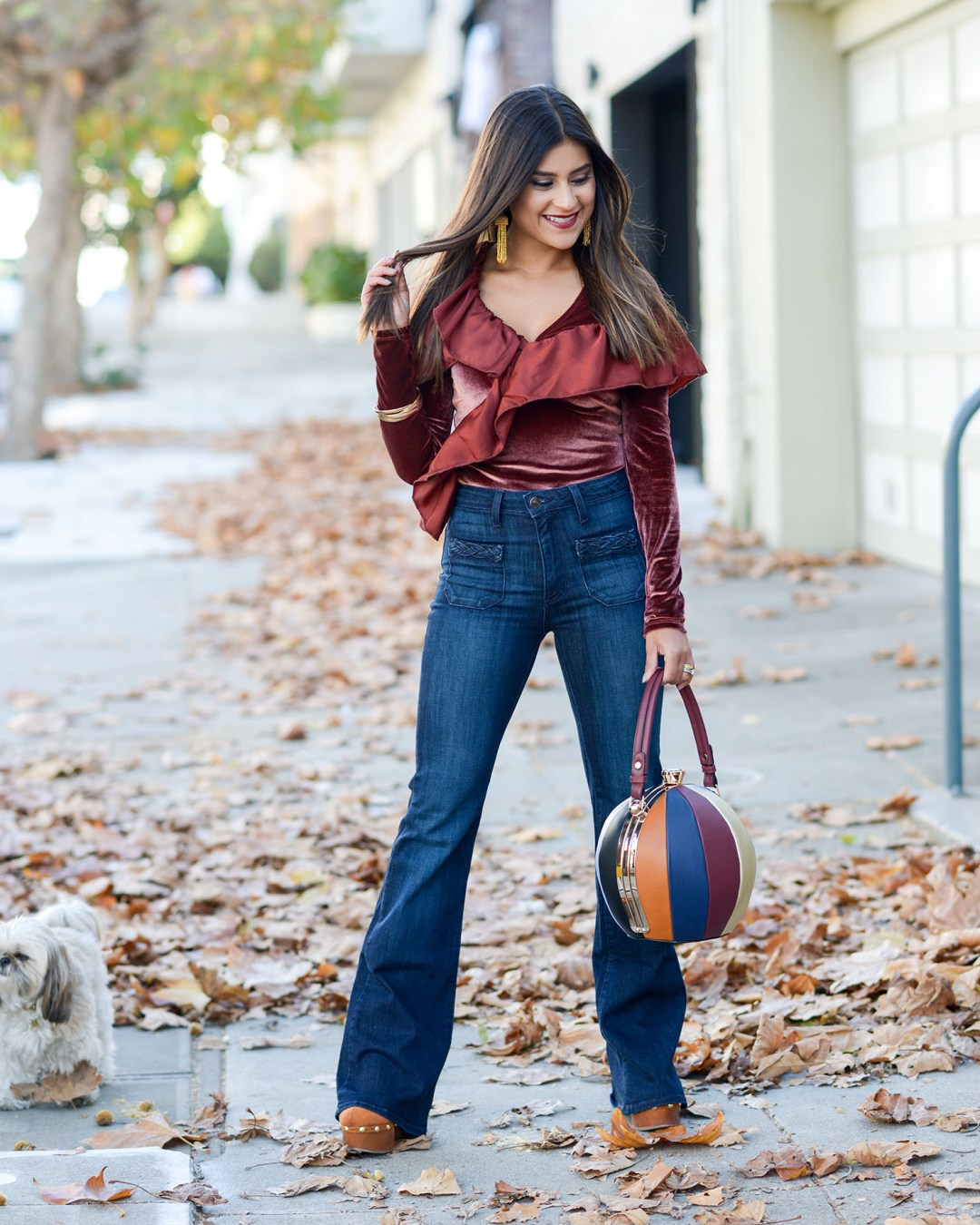 ed8bd3cbe92 Appear a Foot Taller in a Velvet Bodysuit and Flare Jeans