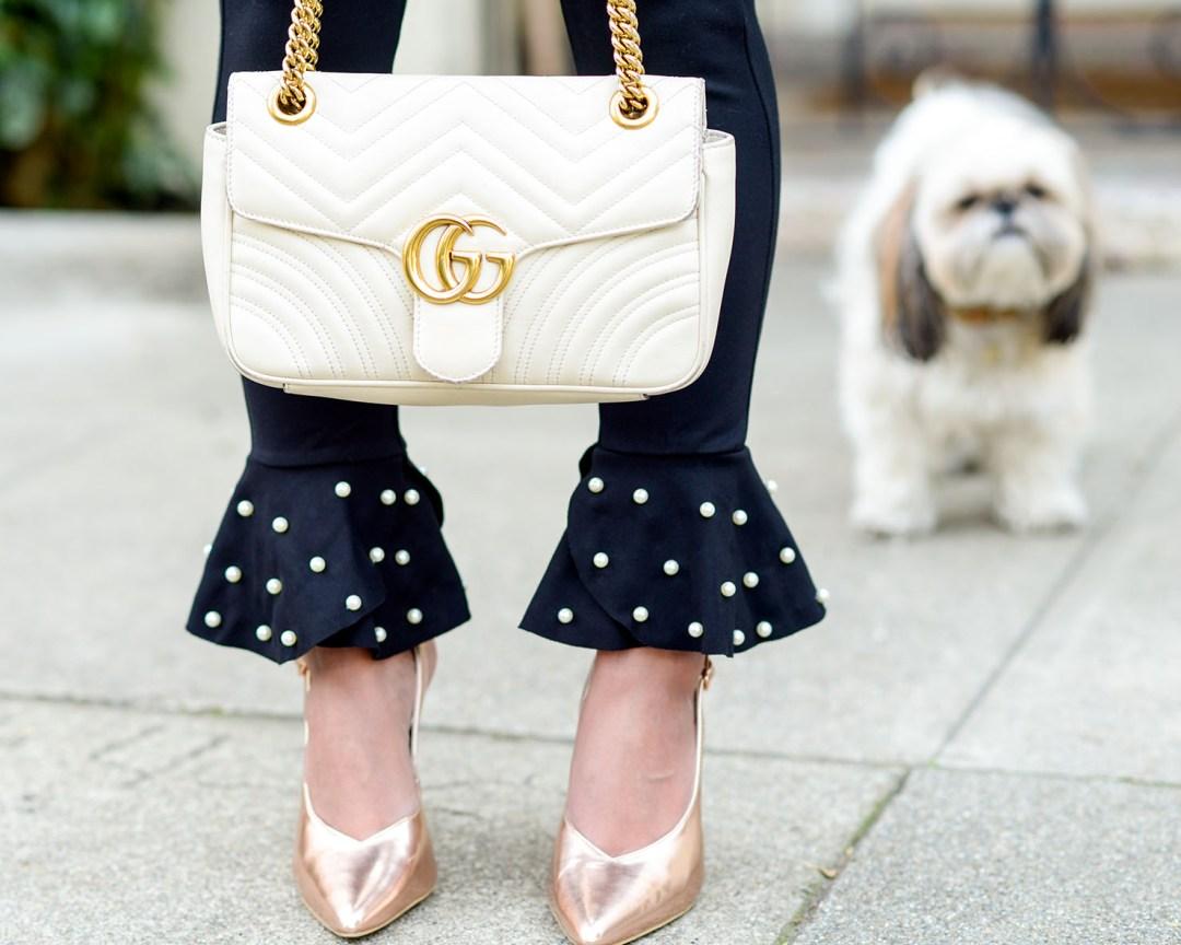 Lifestyle blogger Kelsey Kaplan of Kelsey Kaplan Fashion wearing pearl hem pants and white gucci purse