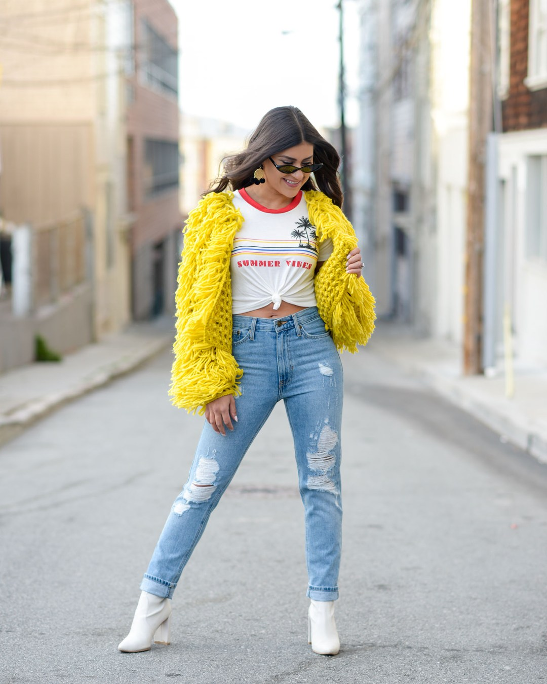 Lifestyle blogger Kelsey Kaplan of Kelsey Kaplan Fashion wearing mom jeans and Stuart Weitzman Clinger booties