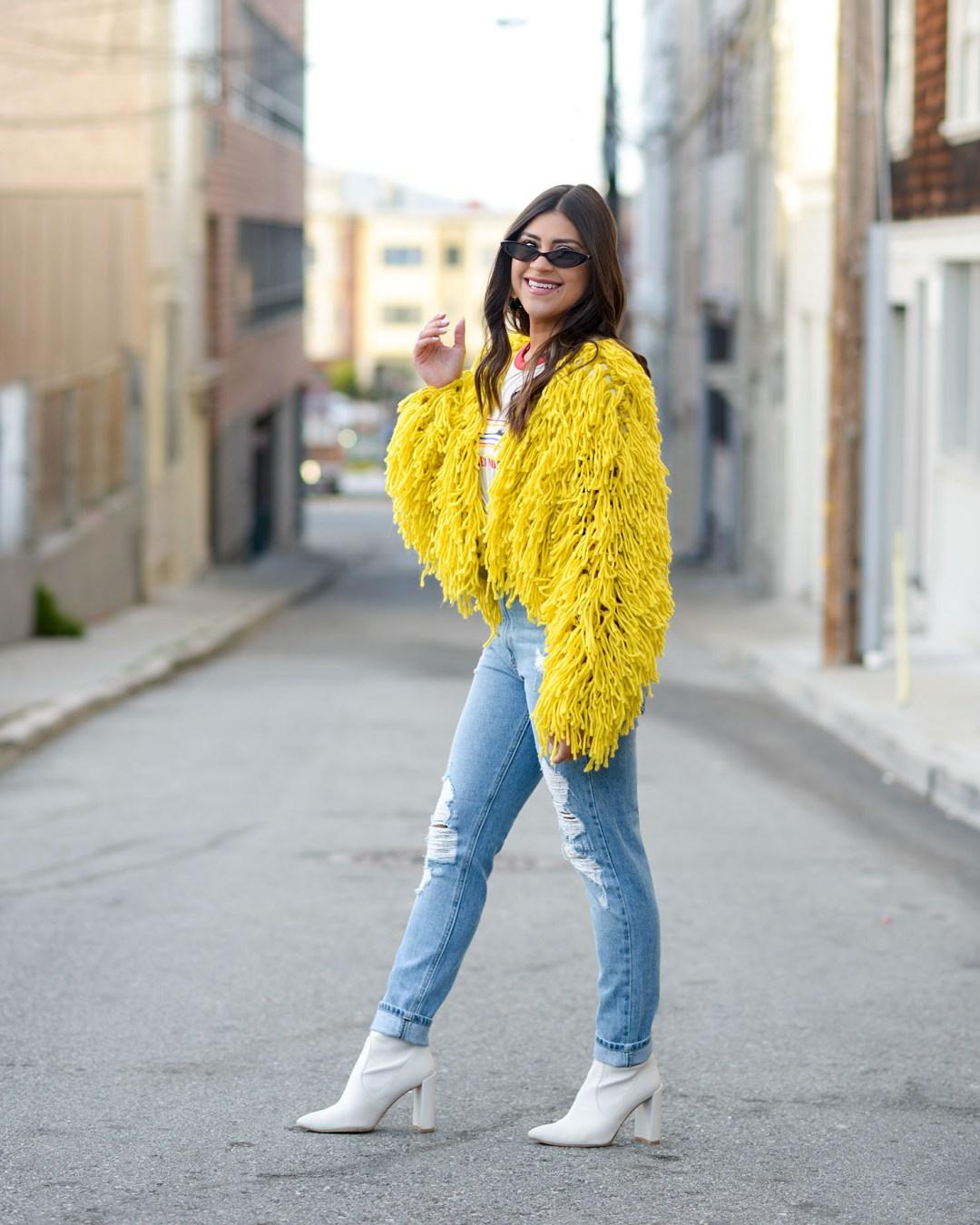 Lifestyle blogger Kelsey Kaplan of Kelsey Kaplan Fashion wearing mom jeans and small cat eye sunglasses