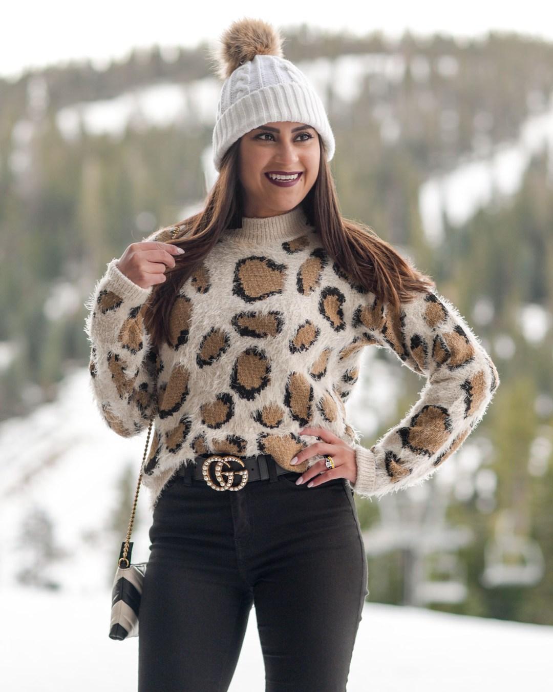 Lifestyle blogger Kelsey Kaplan of Kelsey Kaplan Fashion wearing leopard sweater at Ritz Carlton Lake Tahoe