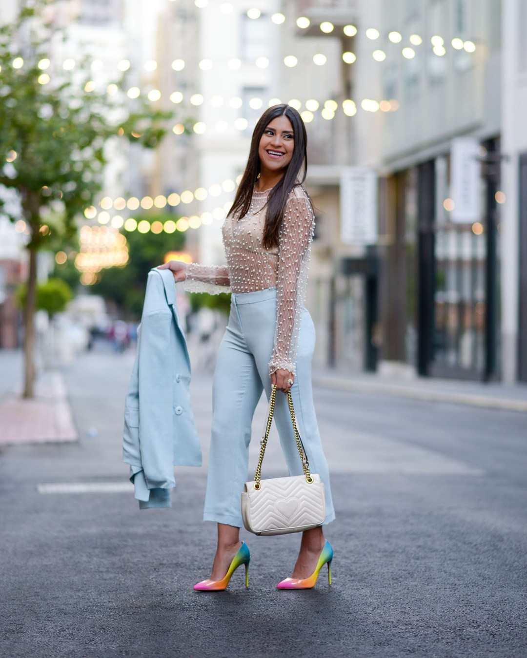 Lifestyle blogger Kelsey Kaplan of Kelsey Kaplan Fashion wearing blue suit and rainbow Christian Louboutin Pigalle Pumps
