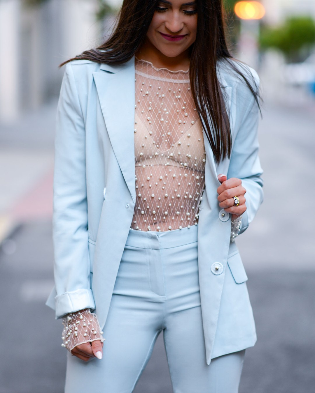 Lifestyle blogger Kelsey Kaplan of Kelsey Kaplan Fashion wearing blue suit and pearl beaded bodysuit