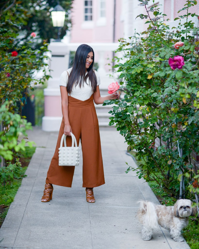 Lifestyle blogger Kelsey Kaplan wearing VICI overalls and pearl beaded purse